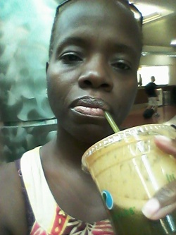 me drinking my green drink at the airport